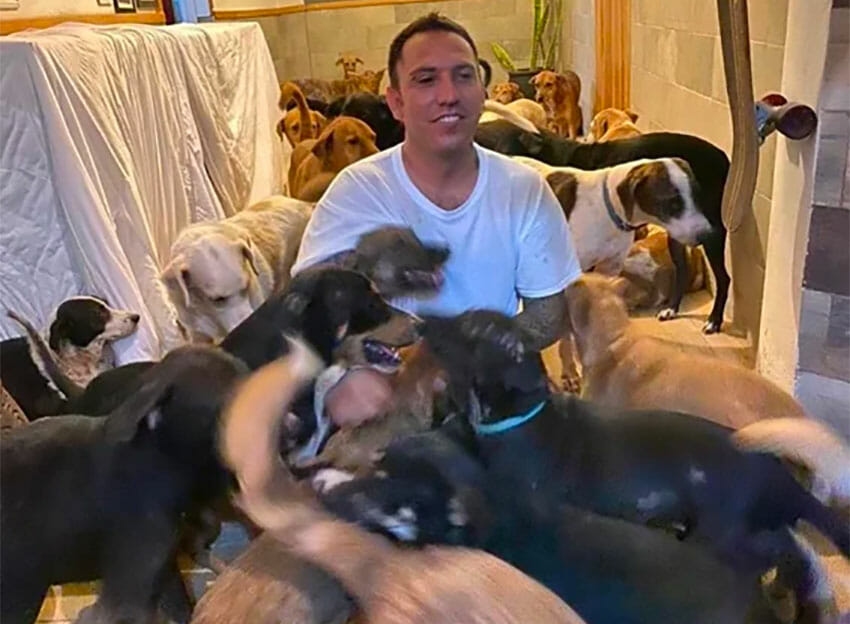 Ricardo Pimentel is surrounded by dogs at his home in Puerto Morelos.