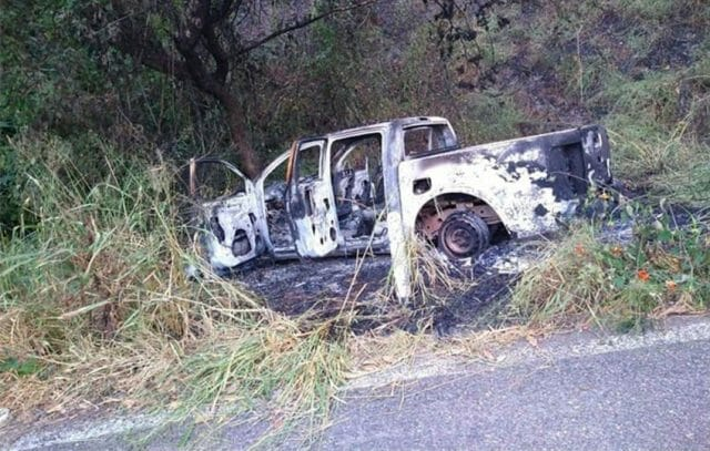 One of 11 vehicles set on fire by a Jalisco cartel cell in western Michoacán.