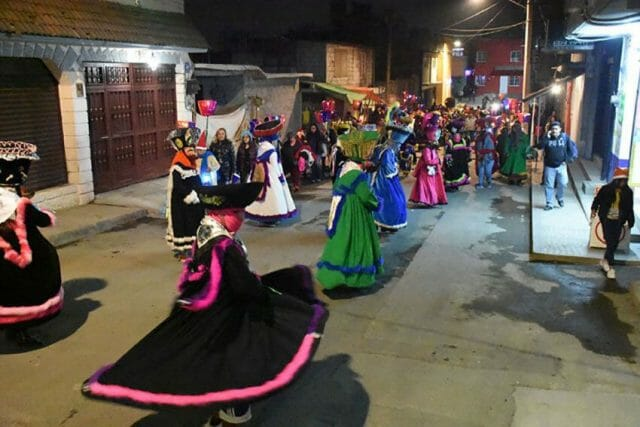Chinelos are costumed dancers who are part of posada processions.