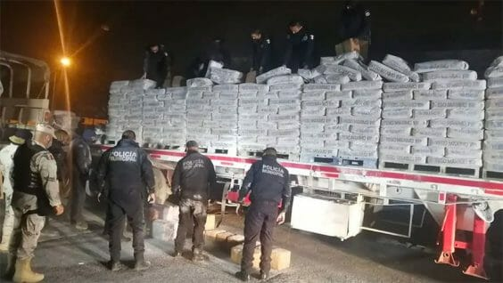 The trailer was carrying a load of plaster and drugs.