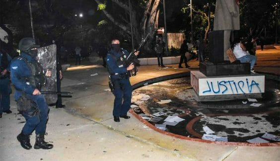 Police fired their weapons during a demonstration in Cancún.