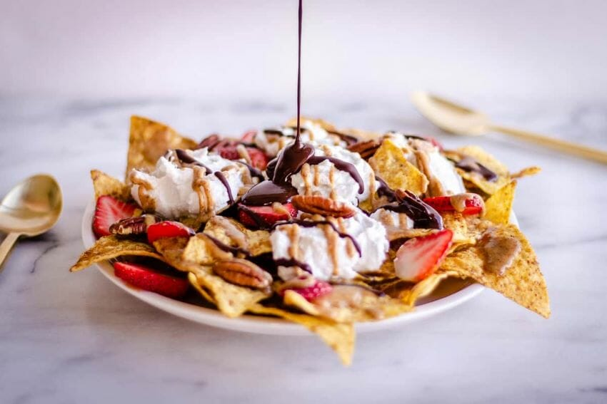 Topped with chocolate and fresh fruit, nachos make an appealing dessert.