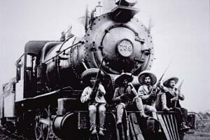 Pancho Villa and friends ride the cowcatcher.