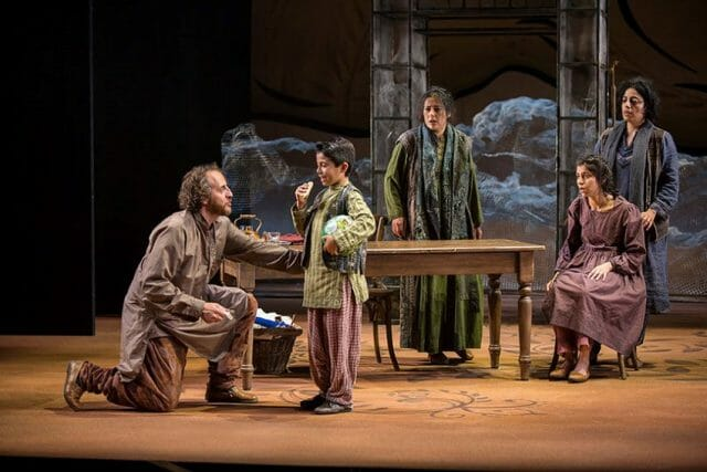 """Arden Pala onstage playing the character of Zalmai in San Diego's Old Globe theater production of """"A Thousand Splendid Suns."""""""