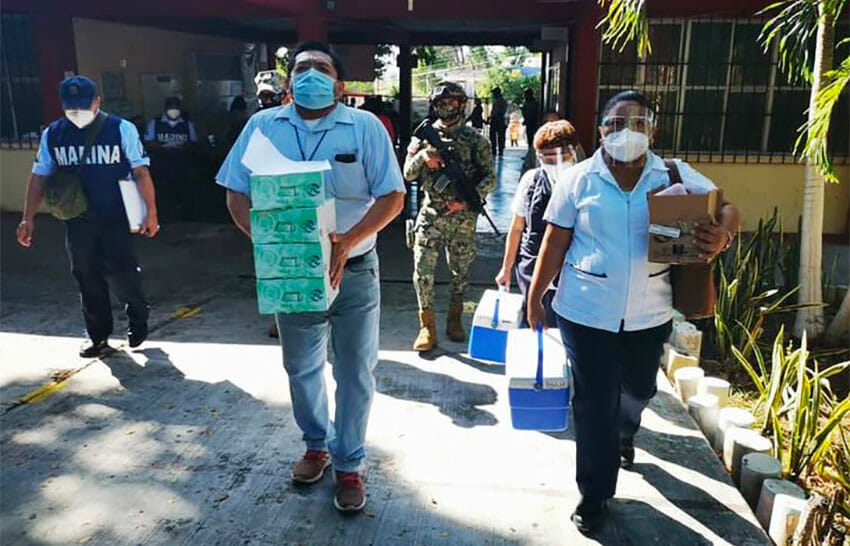 Doses of vaccine arrive at a vaccination center for teachers in Campeche.