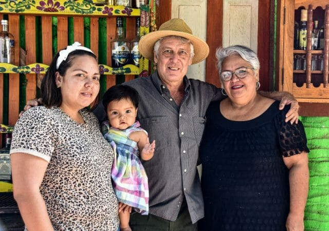 Jesús Espino, the Coconut Museum's founder, with his wife and daughter.