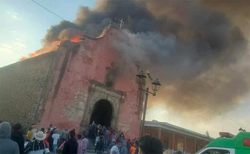 The historic church in flames on Sunday.