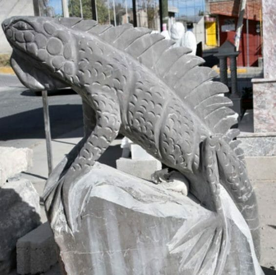 The front of Armando Contreras's workshop is filled with carved marble and onyx figures, including this iguana.