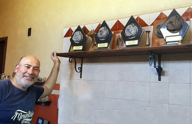 Ortiz with his dog show trophies.