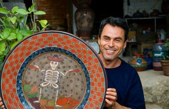 José Luis Cortéz with an example of his pottery.