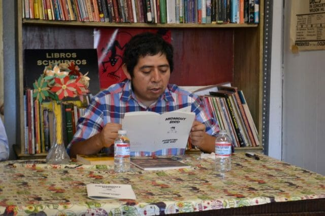 José reading a chapbook of one of his stories at an event at the Libros Schmibros free lending library in Los Angeles, California.