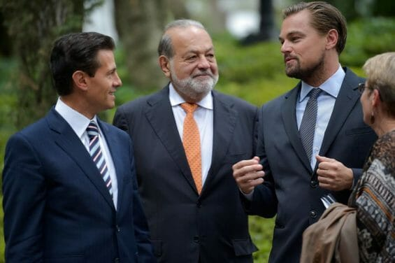 Carlos Slim (center) in 2017, hobnobbing with the rich and famous: former Mexican president Enrique Peña Nieto (left) and actor Leonardo DiCaprio (right).