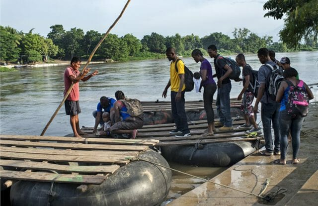 This latest wave of migrants is new, but the problem isn't: Haitian migrants in 2016 crossing the Suchiate River from Guatemala into Chiapas.