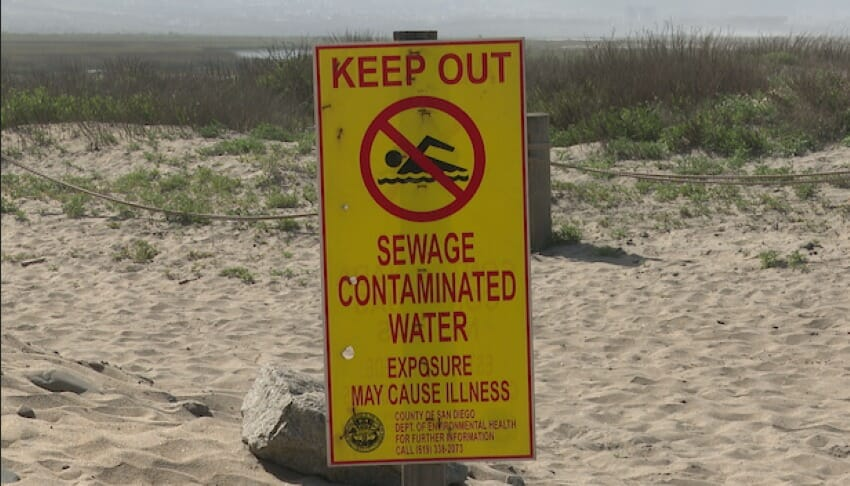 A sign warns Imperial Beach, California residents about water contamination originating from Baja California.