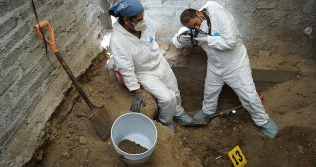 Forensic experts inside the house of suspected Mexican serial killer Andres N.