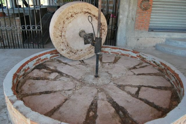 The stone grinding wheel at Hernández's distillery.