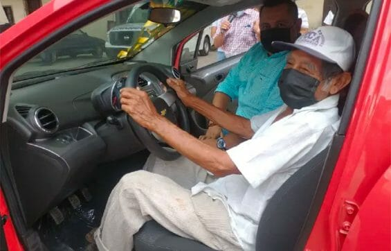 Don Nico in his new Chevrolet Beat.