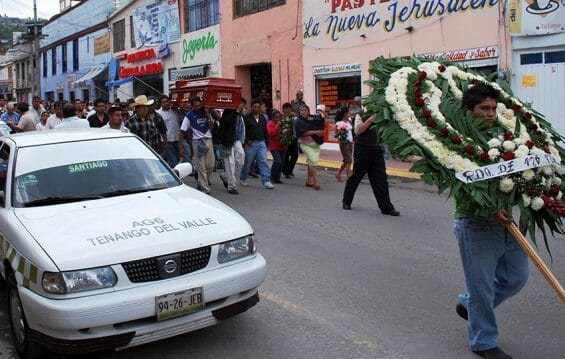 Funeral procession with taxi in Tenango del Valle, México state.