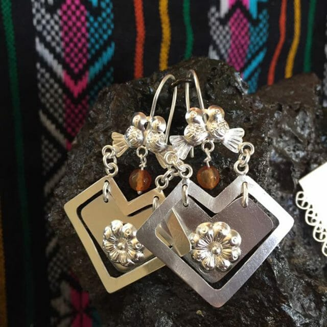 Earrings based on traditional indigenous garment the quexquemitl
