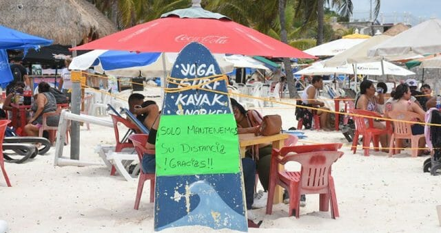 Guests on a Cancún beach restaurant in late May 2021