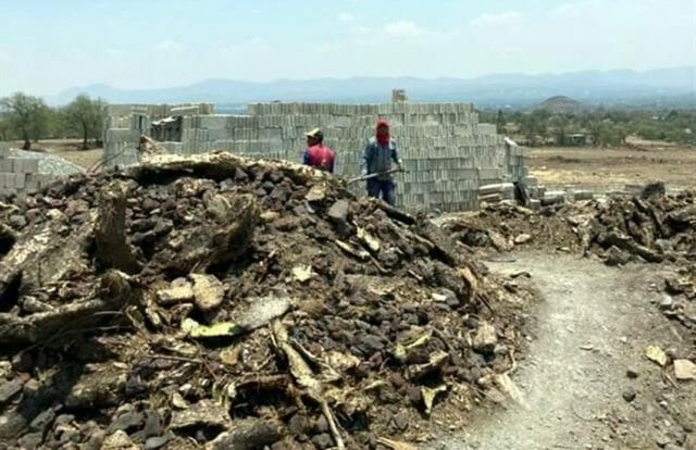 Workers doing illegal construction at Teotihuacan site.
