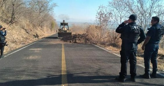 A backhoe clears a blockade earlier this year in Aguililla.