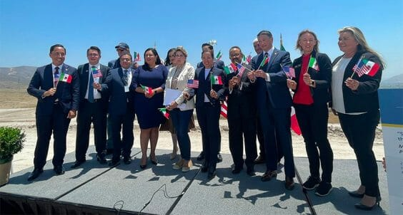 Mexican and US officials celebrating signing of agreement on Monday.