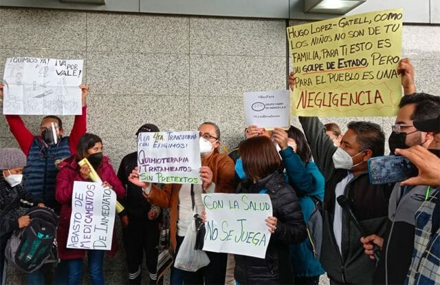 Parents protest cancer medications shortages at Mexico City airport Wednesday.