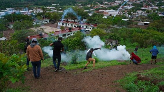 Citizens lob firecrackers and stones at the army's helicopter landing pad in Aguililla.
