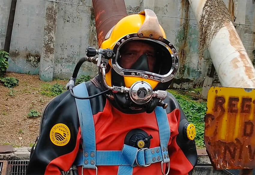 Julio César Cu suited up and ready for a swim in sewage.