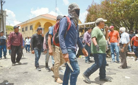 Members of El Machete self-defense group took control of the municipal government building mid-day on Monday.