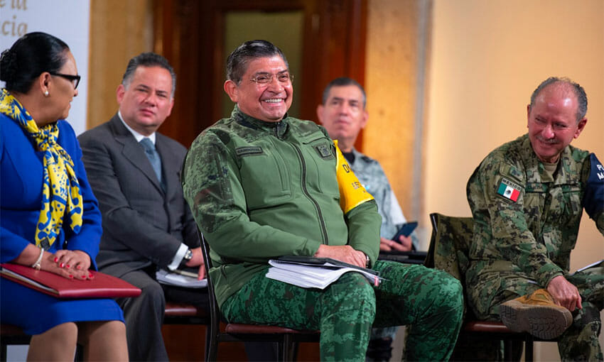 Defense Minister Sandoval enjoys a good laugh during Tuesday's conference.