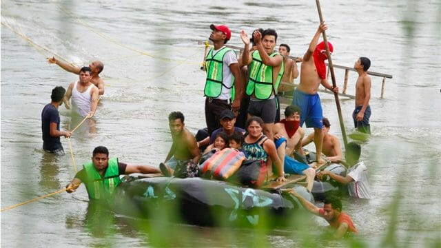 Migrants cross the Suchiate River between Mexico and Guatemala.