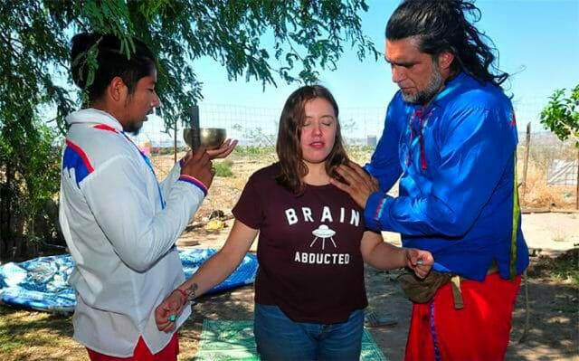 Shaman Octavio Rettig, right, and a candidate for treatment.