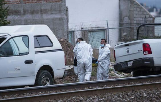 Forensic personnel recover two bodies Thursday in Zacatecas.