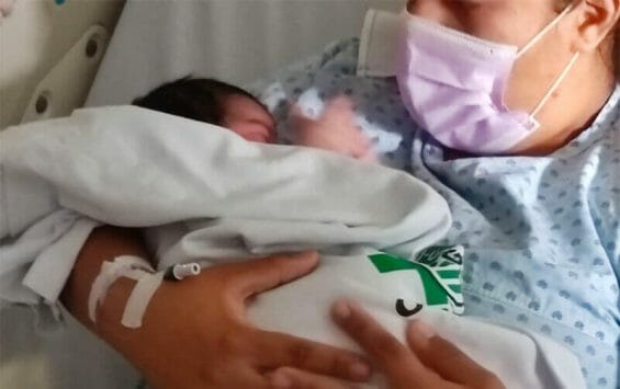 The baby was back in her mother's arms Thursday.
