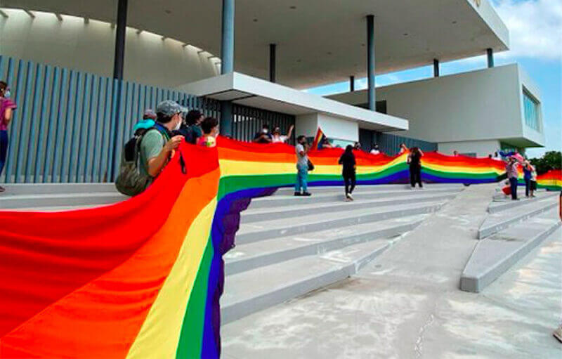 Supporters of the bill with a rainbow banner outside the legislature on Wednesday.