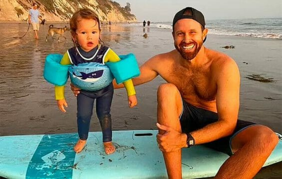 Surfing instructor Coleman with his son.