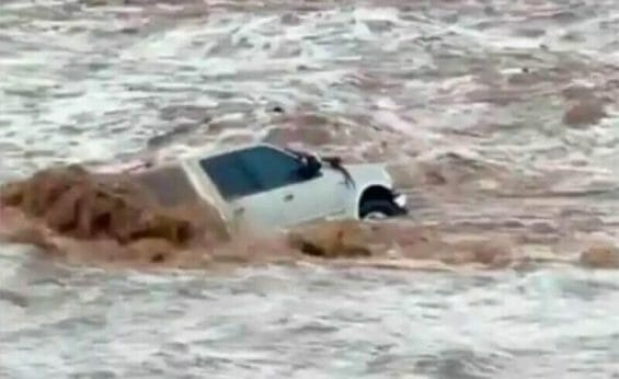 The vehicle from which a woman escaped in a flooded arroyo.