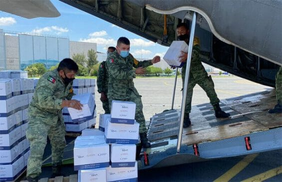 Government personnel load aid supplies onto a plane, in an image shared by the the Foreign Ministry