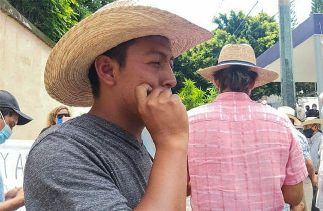 One of the people at the gathering in the Morelos capital tokes up in support of their campaign.