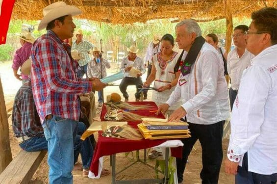 The president meets with Yaqui representatives last August in Sonora.