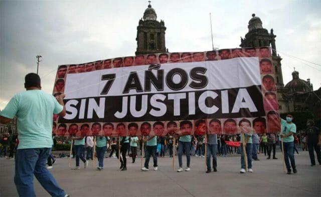 '7 years without justice,' reads a giant banner in the zócalo on Sunday.
