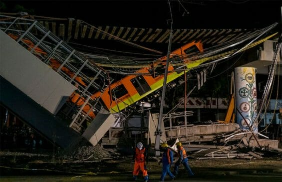 Firefighters and Civil Protection personnel work at the site of the Mexico City metro accident in May.