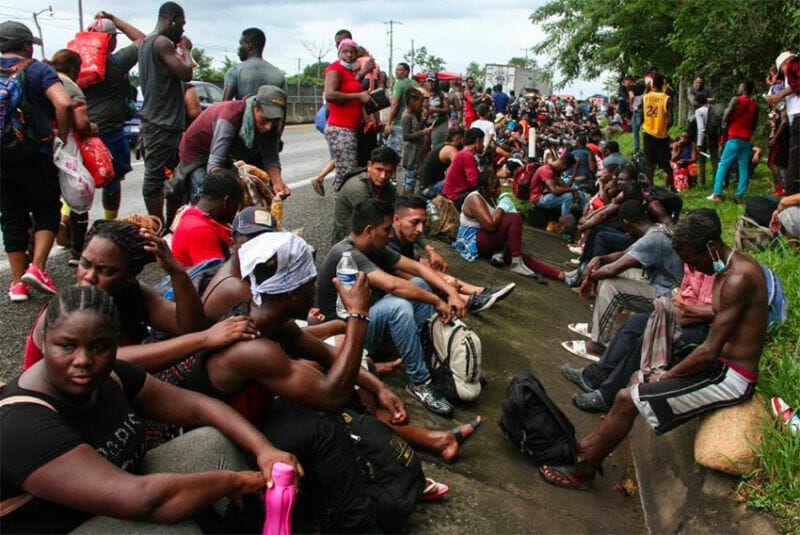 Migrants stop to rest on a Chiapas highway.