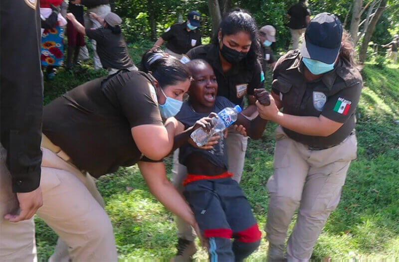 Immigration agents drag a screaming youngster out of the woods in Chiapas on Thursday.