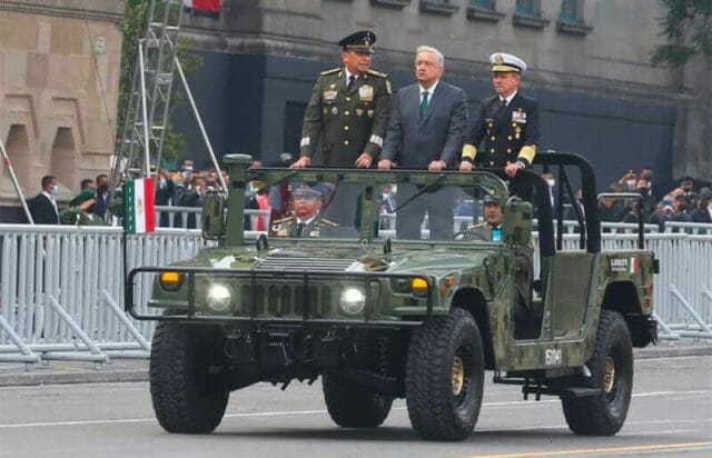 The president rides in the military parade in Mexico City Thursday with the the heads of the armed forces.