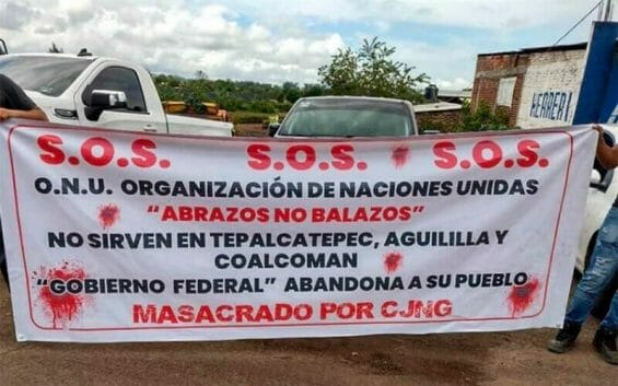 A banner declares an S.O.S. in Apatzingán on Sunday.