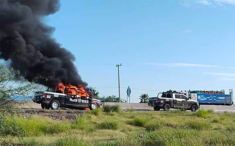 A police vehicle burns in Altar.