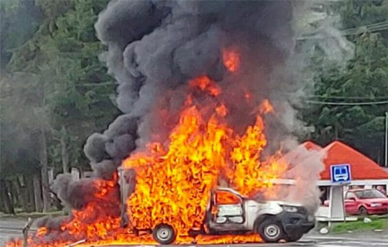 A delivery truck burns at a highway blockade in Michoacán